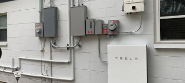 Tesla Powerwall on the outside of a house
