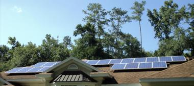Roof of a home with black solar panels on it